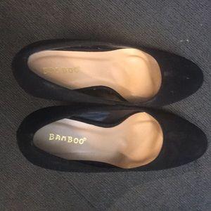 Three inch block heel pumps